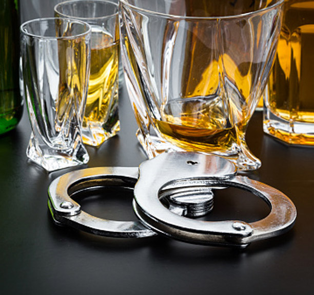 Glasses of alcohol and handcuffs